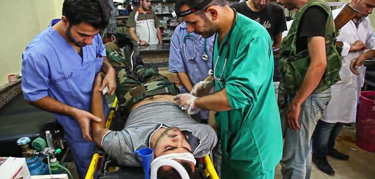 Doctors and medical staff treating injured rebel fighters and civilians in Aleppo / Source: Wikimedia Commons and Scott Bobb